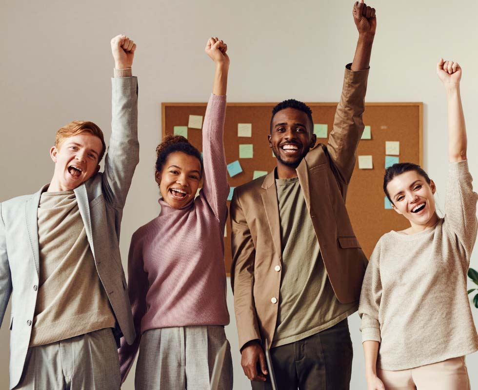 A group of people raising their arms and cheering