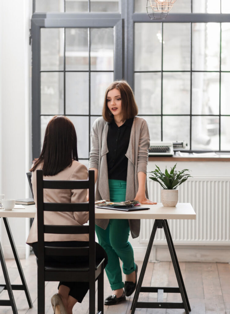 A woman CEO interviews a perspective candidate in her office.